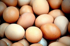 fresh brown eggs in refrigerator